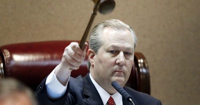 Chief justice's suspension adds to Alabama's political mess