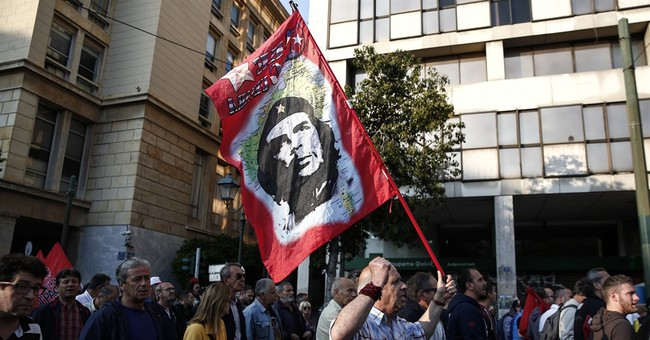 Greek communists protest pension, tax reforms