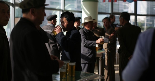 For tired Pyongyang workers, beer's on tap at stand-up bars