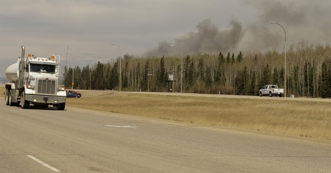 Alberta premier says oil city saved from worst of wildfire