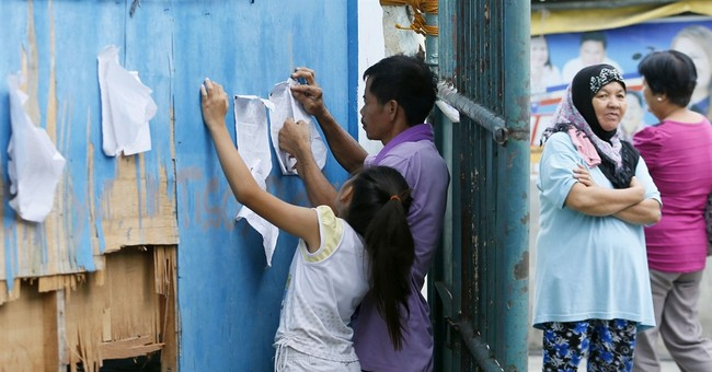 Filipinos set to vote: Slow reform or promise of big change?