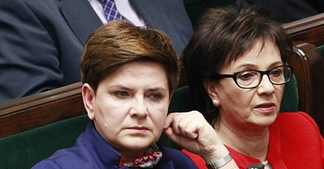 EU opens case against Poland over new media, court laws