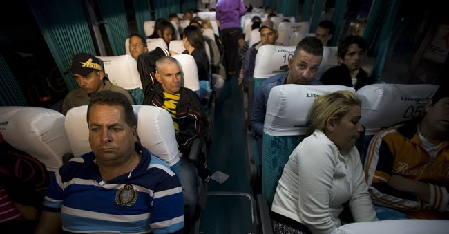 Stranded Cuban migrants brought by air, bus to Mexico