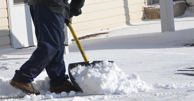 Rising snow closes schools, highways in Northeast