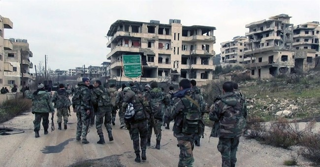 With Russian help, Syrian army pushes into rebel bastion