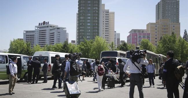 Reporters in N. Korea for congress get wire factory instead