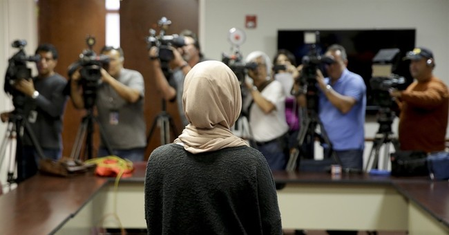 The Latest: Muslim student says yearbook photo ID hurts