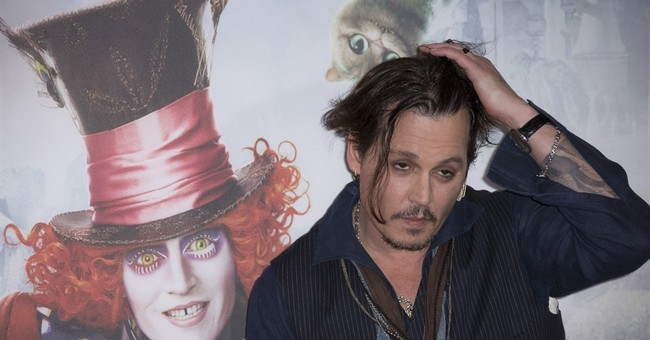 Actor Johnny Depp mocks his 'war on terrier' apology