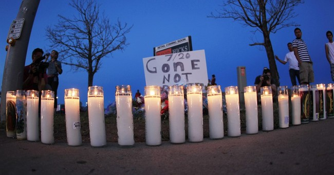 The Latest: Jury selected in theater shooting civil trial