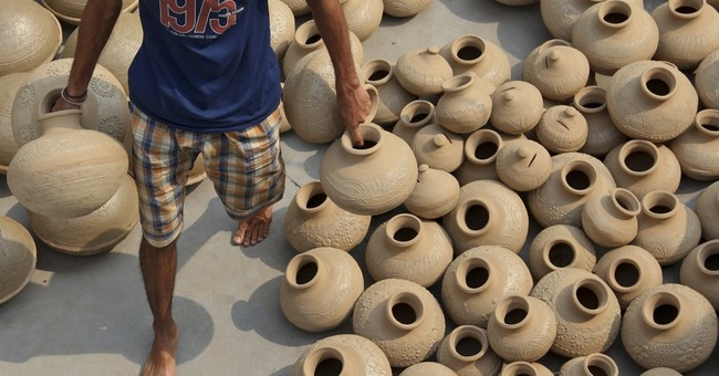 Image of Asia: Newly made earthen pots ready for the oven