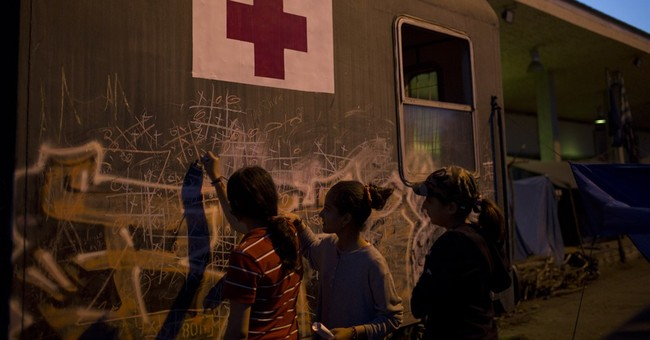 The Latest: Hungary allows tougher asylum-seeker conditions
