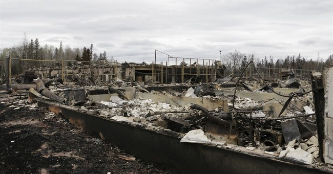 Evacuees from Alberta fire start receiving money