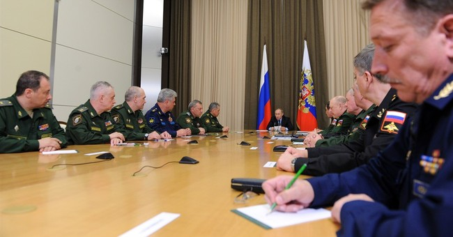 Putin says new Russian weapons turned tide in Syria