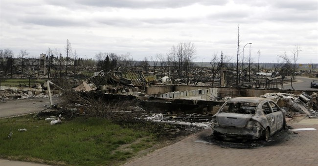 Mixture of loss, hope for Canadian town hit by wildfire