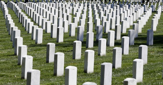 Obama gets bill to allow female pilots' ashes at Arlington