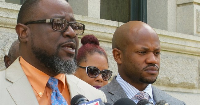 Slain man's family, lawyer praise charges against ex-officer