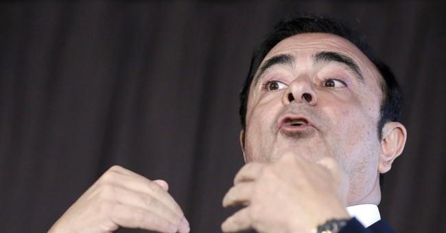 Nissan reports drop in profit, taking stake in Mitsubishi