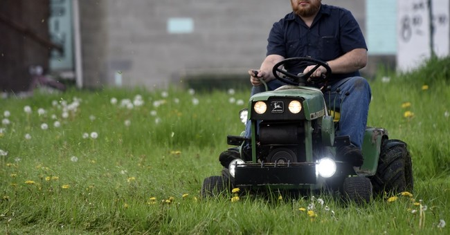 Volunteer Detroit park grass cutters try blindfolded mowing