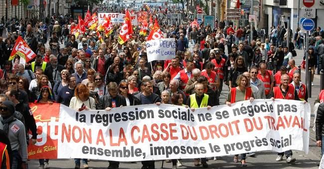 The Latest: French premier survives no-confidence vote