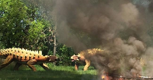 Massive robotic dinosaur destroyed by fire; skeleton remains
