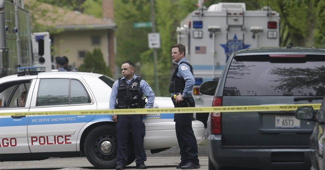 The Latest: Chicago Police: Man in standoff killed himself