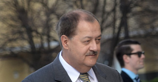 Former Massey Energy CEO Don Blankenship reports to prison