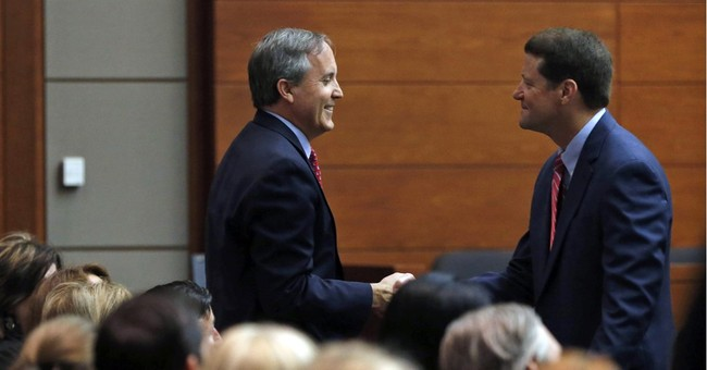 Texas' attorney general defiant as fraud case back in court