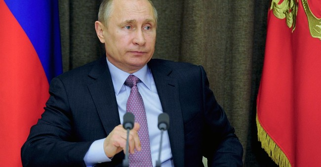 Putin says Russian arms industries meet production targets