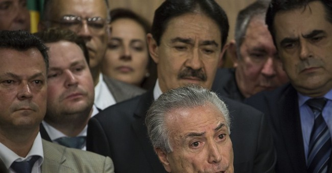 The Latest: Brazil's acting president names all-male Cabinet