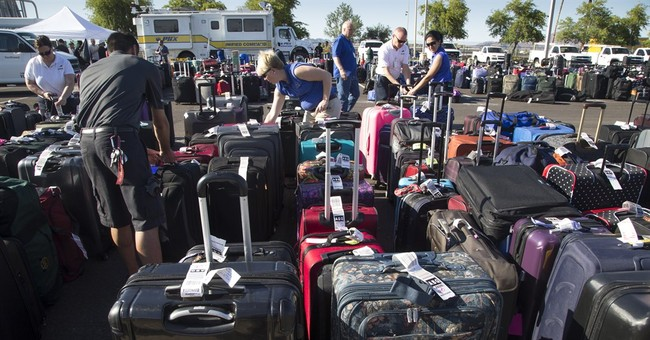 The Latest: Bags moving at Phoenix airport a day after delay