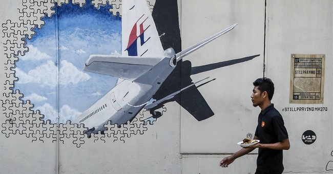 Malaysia: 2 more pieces 'almost certainly' from Flight 370