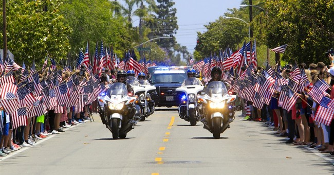 Crowds line streets to honor US Navy SEAL killed in Iraq
