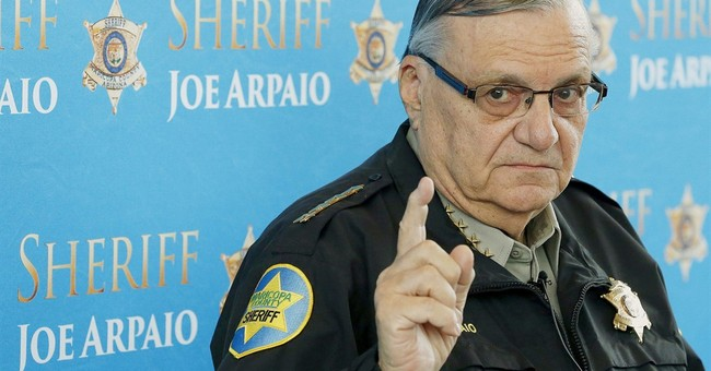 The Latest: Arpaio lawyers disagree with judge's findings