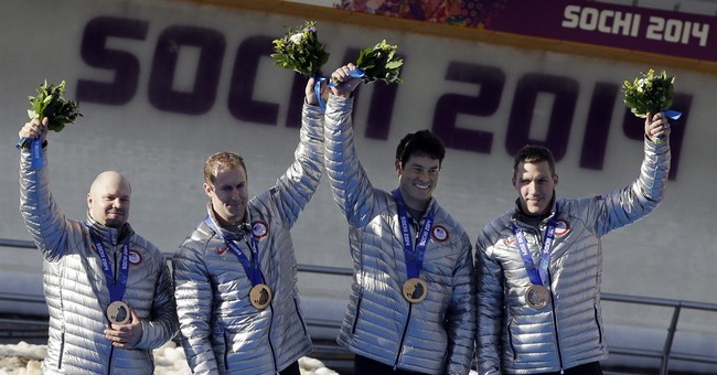 Silver surprise, then another unexpected moment for Holcomb