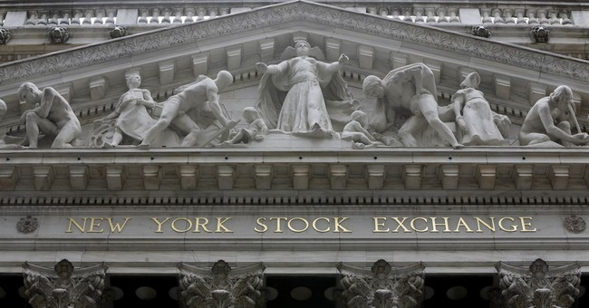 US stocks take a late tumble as retail suffering continues