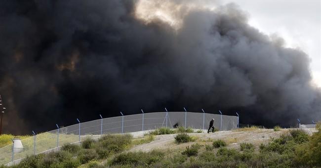 Spaniards evacuated due to massive tire fire return home