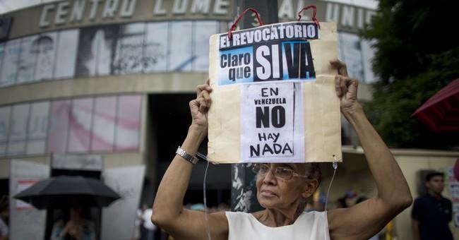 Maduro threatens to seize idle Venezuela plants, jail owners