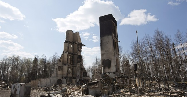 Alberta reviews re-entry plan as flames spread north