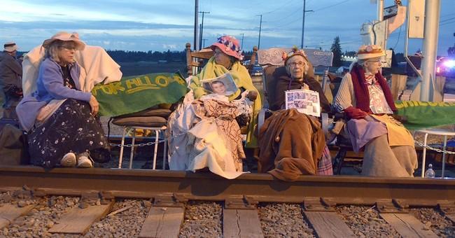 The Latest: 52 activists cited for trespassing Washington