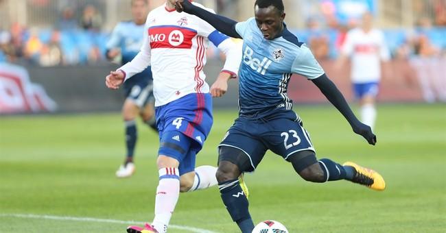 Whitecaps outscore Toronto FC 4-3