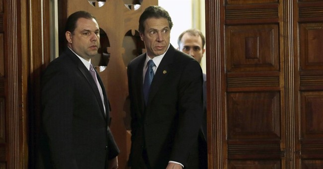 Probe of aides threatens to taint NY gov's marquee programs