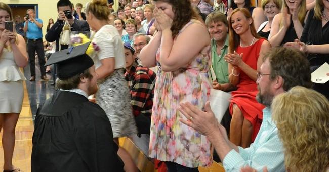 Maine college grad praises peers, proposes to girlfriend