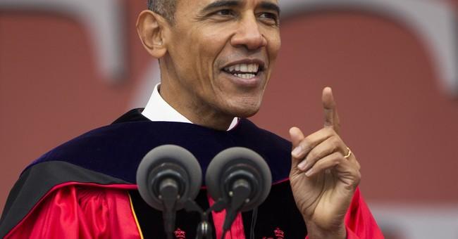 Rebuking Trump, Obama tells graduates walls won't solve ills