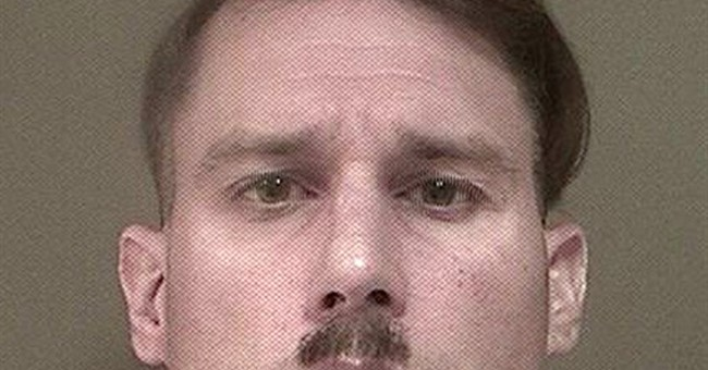 Man with Hitler mustache charged in weapons, ammo case