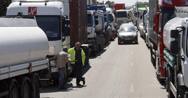 French labor unrest: Tear gas, blocked roads, president firm