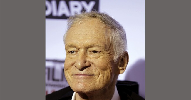 Woman sues Cosby, Hefner, claiming abuse at Playboy Mansion