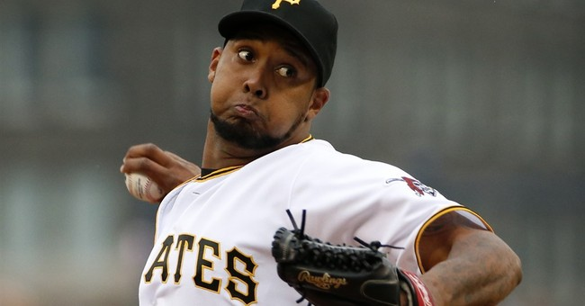 Pirates spoil Snitker's debut as manager, top Braves 12-9