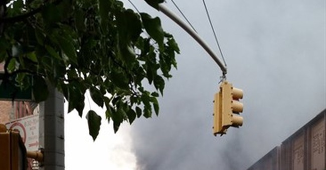 Fire under elevated train tracks in New York halts service