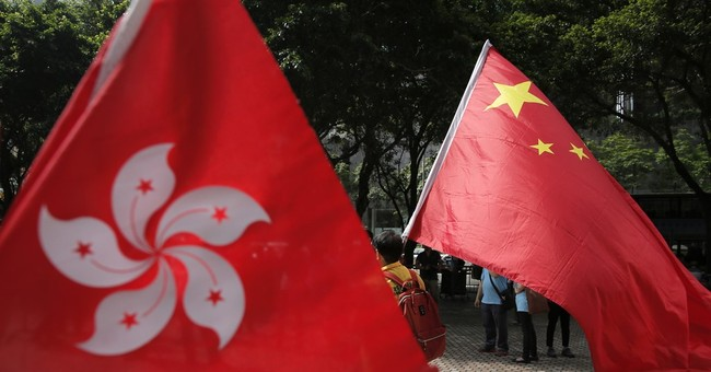 Hong Kong in lockdown as Chinese official attends meeting