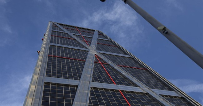 Activists scale Madrid building to protest US trade talks